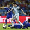 Photo - Argentina's Lionel Messi strolls past Bosnia's Sead Kolasinac during the group F World Cup soccer match between Argentina and Bosnia at the Maracana Stadium in Rio de Janeiro, Brazil, Sunday, June 15, 2014.  (AP Photo/Victor R. Caivano)