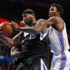 Oklahoma City\'s Hasheem Thabeet (34) goes for the ball behind Sacramento\'s DeMarcus Cousins (15) during an NBA basketball game between the Oklahoma City Thunder and the Sacramento Kings at Chesapeake Energy Arena in Oklahoma City, Friday, Dec. 14, 2012. Photo by Bryan Terry, The Oklahoman