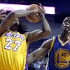 Los Angeles Lakers center Jordan Hill (27) loses the ball with Golden State Warriors forward Harrison Barnes, right, defending, in the first quarter during an NBA basketball preseason game Saturday, Oct. 5, 2013, in Ontario, Calif. (AP Photo/Alex Gallardo)
