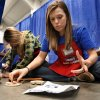 University of Oklahoma students Kendall Jones (front) and Elizabeth Valentine assemble turkey recipe holders as the Cleveland County Fair Board hosts its annual Home and Garden Super Show at the fairgrounds in Norman, Oklahoma on Saturday, February 9, 2008. BY STEVE SISNEY, THE OKLAHOMAN