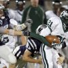 Edmond Santa Fe\'s Ryan Frazier tries to get past Edmond North\'s Nick Washburn, left, and Ragan Land during a high school football game at Wantland Stadium in Edmond, Okla., Friday, Oct. 29, 2010. Photo by Bryan Terry, The Oklahoman