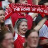 Photo - Arsenal's supporters cheer on the players as the team parade around the stadium in their last home match at the end of their English Premier League soccer match against West Bromwich Albion at Emirates Stadium in London, Sunday, May 4, 2014. (AP Photo/Sang Tan)