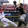 Photo - Cincinnati Reds' Billy Hamilton (6) is safe at home as Pittsburgh Pirates catcher Russell Martin waits for the ball in the first inning of a baseball game, Friday, July 11, 2014, in Cincinnati. Hamilton scored on a hit by Zack Cozart. (AP Photo/Al Behrman)