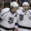 Photo -   Los Angeles Kings' Anze Kopitar, left, of Slovenia, is congratulated by Dustin Brown after scoring during the first period in Game 2 of an NHL hockey Stanley Cup second-round playoff series against the St. Louis Blues, on Monday, April 30, 2012, in St. Louis. (AP Photo/Jeff Roberson)
