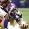 Photo -   Minnesota Vikings wide receiver Percy Harvin, top, is tackled by San Francisco 49ers defensive back Chris Culliver after making a reception during the first half of an NFL football game on Sunday, Sept. 23, 2012, in Minneapolis. (AP Photo/Genevieve Ross)