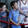 Chase Carbone, 5, and Carter Anderson, 8, both of Lawton, Okla., wait for Kevin Durant to arrive during the red carpet premiere of Thunderstruck at Harkins Bricktown Theatre in Oklahoma City, Sunday, Aug. 19, 2012. Photo by Garett Fisbeck, For The Oklahoman