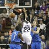 Sacramento Kings guard Isaiah Thomas, center, drives to the basket between Dallas Mavericks\' Rodrigue Beaubois, left, of France, and Dirk Nowitzki, of Germany, during the first quarter of an NBA basketball game in Sacramento, Calif., Thursday, Jan. 10, 2013. (AP Photo/Rich Pedroncelli
