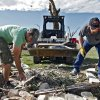 J.T. Chronister, left, and Joe Jainese dig through rubble from a home destroyed by Tuesday\'s tornado north of El Reno, Wednesday, May 25, 2011. Photo by Chris Landsberger, The Oklahoman