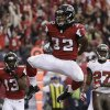 Photo - Atlanta Falcons running back Jacquizz Rodgers (32) celebrates his touchdown against the Tampa Bay Buccaneers during the second half of an NFL football game, Sunday, Oct. 20, 2013, in Atlanta. (AP Photo/John Bazemore)