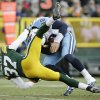 Photo - Green Bay Packers' Sam Shields sacks Tennessee Titans quarterback Jake Locker during the second half of an NFL football game Sunday, Dec. 23, 2012, in Green Bay, Wis. (AP Photo/Morry Gash)