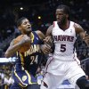 Photo - Indiana Pacers small forward Paul George (24) drives against Atlanta Hawks small forward DeMarre Carroll (5) in the first  half of an NBA basketball game, Tuesday, Feb. 4, 2014, in Atlanta. (AP Photo/John Bazemore)