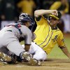 Oakland Athletics\' Seth Smith, right, is tagged out at the plate by Minnesota Twins catcher Josmil Pinto during the second inning of a baseball game Thursday, Sept. 19, 2013, in Oakland, Calif. (AP Photo/Marcio Jose Sanchez)
