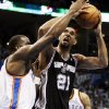San Antonio\'s Tim Duncan (21) shoots against Oklahoma City\'s Kendrick Perkins (5) during Game 4 of the Western Conference Finals between the Oklahoma City Thunder and the San Antonio Spurs in the NBA playoffs at the Chesapeake Energy Arena in Oklahoma City, Saturday, June 2, 2012. Photo by Nate Billings, The Oklahoman