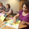 Toni Humphrey, left, Laine Dillinger and Stacey Evans work on projects as new teachers go through training at Cooper Middle School in the Putnam City School District. Photo by Paul Hellstern, The Oklahoman PAUL HELLSTERN - Oklahoman