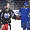 Photo - Canadian Olympic women's team goalie Shannon Szabados gives a low-five to Nail Yakupov during practice with the Edmonton Oilers NHL hockey team in Edmonton, Alberta, Wednesday, March 5, 2014. (AP Photo/The Canadian Press, Jason Franson)