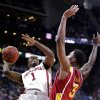 Oklahoma guard Sam Grooms (1) puts up a shot under pressure from Iowa State forward Melvin Ejim (3) during the first half an NCAA college basketball game in the Big 12 Conference tournament Thursday, March 14, 2013, in Kansas City, Mo. (AP Photo/Charlie Riedel) ORG XMIT: MOCR107
