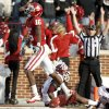 Oklahoma\'s Jaz Reynolds (16) celebrates a touchdown in front of Texas A&M\'s Lionel Smith (3) and Texas A&M\'s Toney Hurd Jr. (4) during the college football game between the Texas A&M Aggies and the University of Oklahoma Sooners (OU) at Gaylord Family-Oklahoma Memorial Stadium on Saturday, Nov. 5, 2011, in Norman, Okla. Oklahoma won 41-25. Photo by Bryan Terry, The Oklahoman