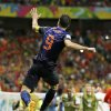 Photo - Netherlands' Robin van Persie celebrates after his scoring his side's fourth goal during the second half of the group B World Cup soccer match between Spain and the Netherlands at the Arena Ponte Nova in Salvador, Brazil, Friday, June 13, 2014.  (AP Photo/Natacha Pisarenko)