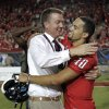 Photo -   Arizona's Athletic Director Greg Byrne, left, and starting quarterback Matt Scott (10) share a hug in celebration of winning an NCAA college football game against Oklahoma State at Arizona Stadium in Tucson, Ariz., Saturday, Sept. 8, 2012. (AP Photo/John Miller)