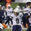 Photo - San Diego Chargers place kicker Nick Novak (9) boots a 25-yard field goal against the Cincinnati Bengals in the second half of an NFL wild-card playoff football game on Sunday, Jan. 5, 2014, in Cincinnati. (AP Photo/David Kohl)