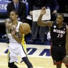 Indiana Pacers\' George Hill makes a pass against Miami Heat\'s Mario Chalmers (15) during the first half of Game 3 of the NBA Eastern Conference basketball finals in Indianapolis, Sunday, May 26, 2013. (AP Photo/Michael Conroy)