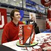 Golfer Griffin Pierce in front of his cake shaped like a golf bag. Athletes from Edmond North High School signed national letters of intent with colleges and universities during a ceremony in the school\'s gymnasium Wednesday morning, Nov. 13, 2013. Various sports include golf, softball, wrestling, lacrosse and others. Photo by Jim Beckel, The Oklahoman