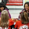 First lady Michelle Obama and Food Network chef Rachel Ray discuss lunches that students from the Eastside and Northside Elementary Schools receive during a