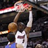 Miami Heat\'s Dwyane Wade (3) dunks in front of New York Knicks\' Landry Fields (2) and Tyson Chandler, right, in the first half of an NBA basketball game in the first round of the Eastern Conference playoffs in Miami, Monday, April 30, 2012. (AP Photo/Lynne Sladky)