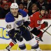 Photo - St. Louis Blues' Maxim Lapierre (40) controls the puck against the Chicago Blackhawks during the second period in Game 4 of a first-round NHL hockey playoff series in Chicago, Wednesday, April 23, 2014. (AP Photo/Nam Y. Huh)