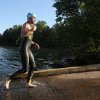 Photo - Six-time NASCAR champion driver Jimmie Johnson finishes the swim portion of the Over the Mountain Triathlon in Kings Mountain, N.C., Saturday, May 17, 2014.  (AP Photo/The Star, Ben Earp)