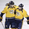 Photo - Nashville Predators forward Craig Smith (15) is congratulated by Mattias Ekholm (42), of Sweden, after Smith scored against the Chicago Blackhawks in the first period of an NHL hockey game Saturday, April 12, 2014, in Nashville, Tenn. (AP Photo/Mark Humphrey)