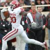 Oklahoma\'s Javon Harris returns an interception for a touchdown against Texas Tech during an NCAA college football game in Lubbock, Texas, Saturday, Oct. 6, 2012. (AP Photo/Lubbock Avalanche-Journal, Stephen Spillman) LOCAL TV OUT