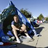 Michael Ooten, a junior, sits in front of a tarp shelter; the plastic container at his feet is for spare change he asks from from fellow students on their way to class. UCO students are living in cardboard boxes near Broncho Lake for a week as an activity to raise funds in conjunction with Poverty Awareness Week. Ooten is a member of Sigma Tau Gamma. Photo taken Oct. 8, 2008. BY JIM BECKEL, THE OKLAHOMAN