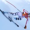 Photo - Germany's Maria Hoefl-Riesch makes a turn in a women's downhill training run for the Sochi 2014 Winter Olympics, Friday, Feb. 7, 2014, in Krasnaya Polyana, Russia. (AP Photo/Alessandro Trovati)