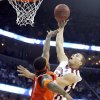 Oklahoma\'s Blake Griffin (23) puts up a shot over Syracuse\'s Paul Harris (11) during the second half of the NCAA Men\'s Basketball Regional at the FedEx Forum on Friday, March 27, 2009, in Memphis, Tenn. PHOTO BY CHRIS LANDSBERGER, THE OKLAHOMAN