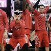 From left, Houston Rockets\' Chandler Parsons, Jeremy Lin, Patrick Patterson, Carlos Delfino and Greg Smith celebrate a teammate\'s 3-pointer against the Utah Jazz in the fourth quarter of their NBA basketball game, Monday, Jan. 28, 2013, in Salt Lake City. The Rockets won 125-80. (AP Photo/Rick Bowmer)