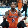 Photo - New York Knicks' J.R. Smith (8) reacts after being called for a foul against the Atlanta Hawks during the first half of an NBA basketball game Saturday, Nov. 16, 2013, in New York.  Atlanta defeated New York 110-90. (AP Photo/Jason DeCrow)