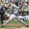 Photo -   New York Yankees starting pitcher CC Sabathia throws against the Oakland Athletics during the first inning of their baseball game Sunday, July 22, 2012 in Oakland, Calif. (AP Photo/Eric Risberg)