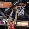Photo - Houston Rockets forward Chandler Parson catches a lob pass for a dunk against the Sacramento Kings during the first quarter of an NBA basketball game in Sacramento, Calif., Wednesday, April 3, 2013. (AP Photo/Rich Pedroncelli)