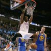 Oklahoma City\'s Kendrick Perkins (5) dunks the ball beside Golden State\'s David Lee (10) during an NBA basketball game between the Oklahoma City Thunder and the Golden State Warriors at Chesapeake Energy Arena in Oklahoma City, Wednesday, Feb. 6, 2013. Photo by Bryan Terry, The Oklahoman
