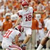 SPECIAL TEAMS: B After Michael Hunnicutt, pictured, missed the field goal late against Texas Tech, this grade appeared to be headed south. But the freshman, who took over in September from \'made em but ugly\' Jimmy Stevens, really did rebound to have an above-average season (20 for 23, including all four beyond 40) and show promise for the future. Tress Way was solid throughout the bulk of the season, only missing a punt here or there. His average was lower, maybe, but he had 33 of 57 punts inside the 20 and didn\'t have a touchback until November. The kick coverage team improved after giving up the return to Fozzy Whittaker in the Texas game. Franks provided a little spark toward the end of the year on kick returns, but OU\'s still not getting nearly enough, considering it recruits some of the fastest guys in the country. Losing Broyles hurt on punt returns. All this said, a special teams coordinator could be a good move for OU in the future. Generally, this area of the game isn\'t taken advantage of enough at the college level.