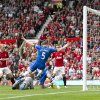 Photo -   Manchester United's Paul Scholes, second left, scores against Wigan Athletic during their English Premier League soccer match at Old Trafford Stadium, Manchester, England, Saturday, Sept. 15, 2012. (AP Photo/Jon Super)