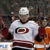 Carolina Hurricanes\' Joni Pitkanen celebrates his goal in the first period of an NHL hockey game against the Philadelphia Flyers, Saturday, Feb. 2, 2013, in Philadelphia. (AP Photo/Tom Mihalek)