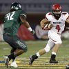 Mustangs\' Frankie Edwards looks to get past Edmond Santa Fe\'s Austin Mack during the high school football game between Edmond Santa Fe and Mustang at Wantland Stadium in Edmond, Okla., Thursday, Oct. 3, 2013. Photo by Sarah Phipps, The Oklahoman