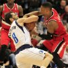 Photo - Dallas Mavericks guard Jose Calderon (8), of Spain, and Portland Trail Blazers guard Damian Lillard (0) battle for the ball during the first half of an NBA basketball game on Friday, March 7, 2014, in Dallas. (AP Photo/John F. Rhodes)