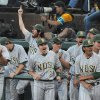 Photo - The North Dakota State bench celebrates a home run by Kyle Kleinendorst during an NCAA college baseball tournament regional game against Oregon State in Corvallis, Ore., Friday, May 30, 2014. (AP Photo/Mark Ylen)