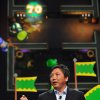 FILE - In this June 5, 2012 publicity file photo provided by Nintendo of America, Katsuya Eguchi, Producer of Software Development for Nintendo, shows off