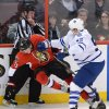 Ottawa Senators\' Jakob Silfverberg gets hit by Toronto Maple Leafs\' Korbinian Holzer during the second period of an NHL hockey game in Ottawa, Ontario, on Saturday, Feb. 23, 2013. (AP Photo/The Canadian Press, Sean Kilpatrick)