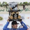 Martin Truex Jr. holds up his trophy after winning the NASCAR Sprint Cup series auto race on Sunday, June 23, 2013, in Sonoma, Calif. (AP Photo/Eric Risberg)