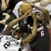 San Antonio Spurs\' Kawhi Leonard (2) and Miami Heat\'s LeBron James (6) battle for a rebound during the first half at Game 4 of the NBA Finals basketball series, Thursday, June 13, 2013, in San Antonio. (AP Photo/David J. Phillip)